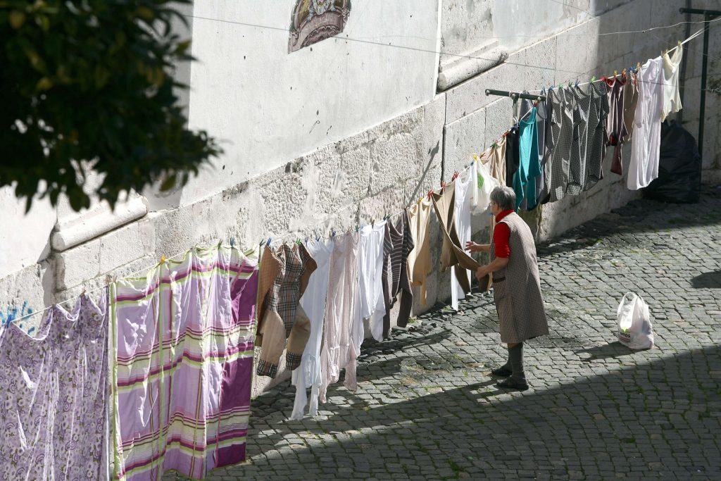 Lady doing laundry in Lisbon